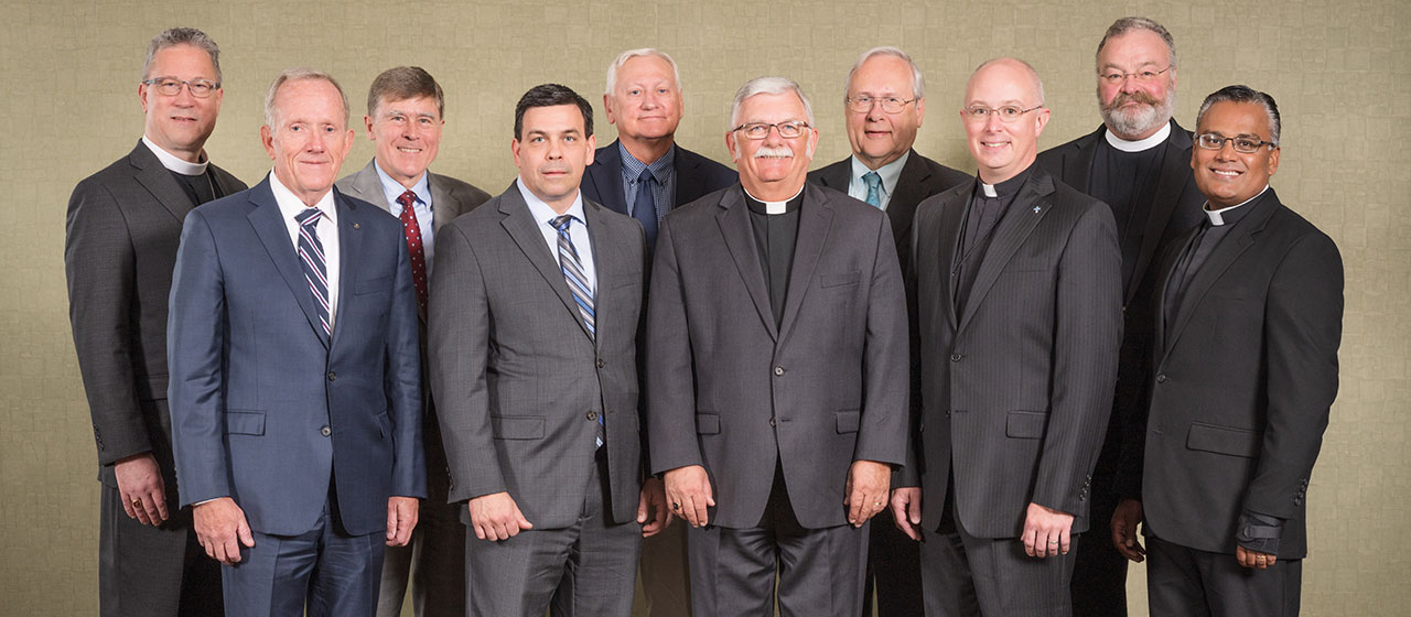 LCMS Board of Directors members (from left to right): Rev. Peter Lange, first vice-president; Mr. Larry Harrington, Mr. Christian Preus; Mr. Andrew Grams; Dr. Jan Lohmeyer; Rev. Dr. Michael Kumm, chairman; Dr. Jesse Yow; Rev. Dr. John Sias, secretary; Rev. Dr. Matthew C. Harrison, president; and Rev. Josemon Hoem. Not pictured: Ed Everts, Keith Frndak and Rick Stathakis.