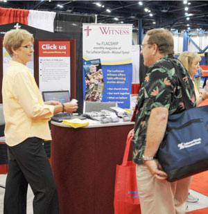 A convention delegate visits with a representative of the LCMS Church Information Center in the exhibit hall at the 2010 Synod Convention in Houston.
