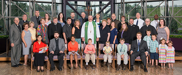 A group portrait of missionaries with LCMS Rev. Dr. Matthew C. Harrison (Center) during missionary orientation, June 2014.